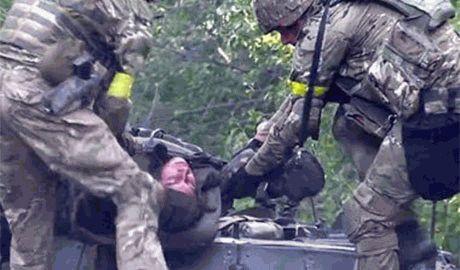 Под Иловайском активисты нашли 13 обезображенных тел погибших украинских солдат