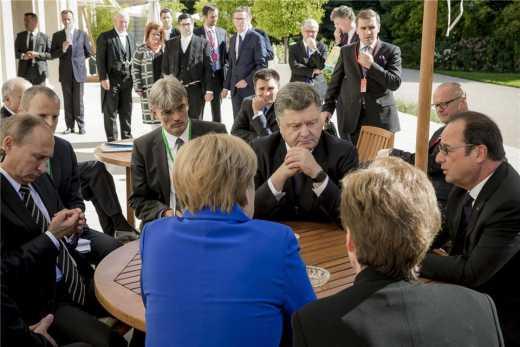 В Париже договорились о выводе российских войск с захваченной территории Донбасса
