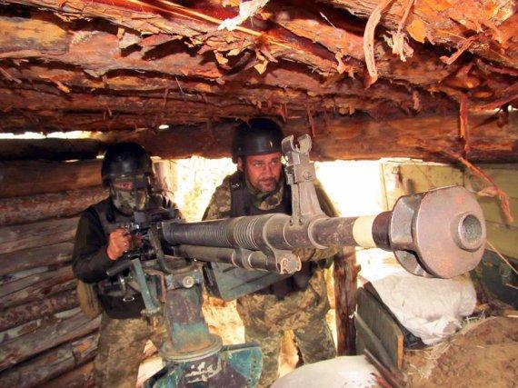 """ВСУ показали, как дают боевикам """"успокаивающие пилюли"""" 12,7 калибра. ФОТО"""