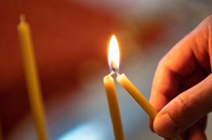 В Харьковской области умершая от коронавируса женщина продавала в церкви свечи
