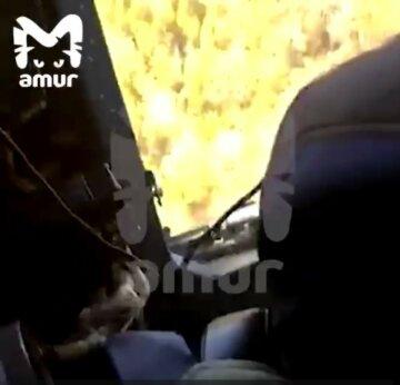 """Найдены обломки рухнувшего самолета с россиянами, первые кадры: """"Воткнулся в сопку"""""""